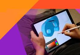 Vista superior de un técnico diseñador gráfico creando contenido visual sobre tablet