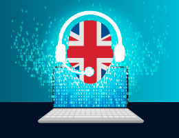 Silueta de una cara con colores de bandera inglesa y audifonos blancos sobrepuesta en pantalla de laptop pixeleada